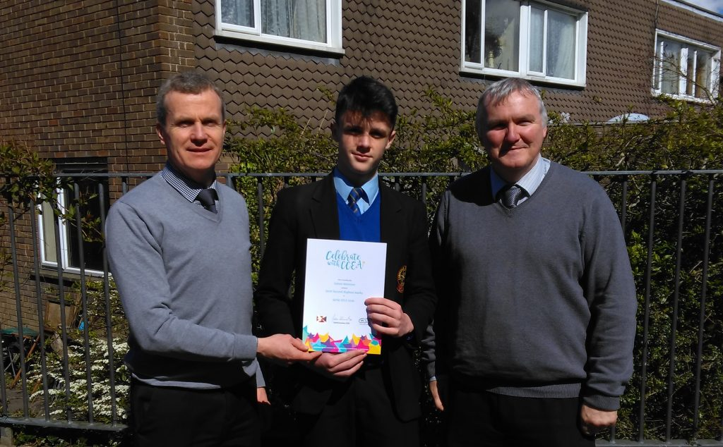 James Mannion Joint 2nd at CCEA receives his certificate from Mr P Donnelly (Head of Irish) and Mr J Murray (Head of School - Years 11&12)
