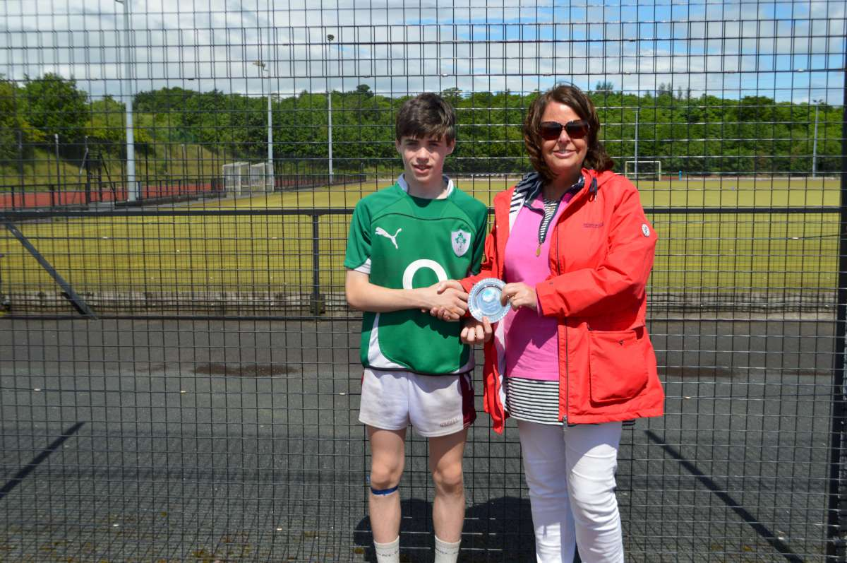 Conor McGillion receieves his award from Head of Year 8 Ms Devlin