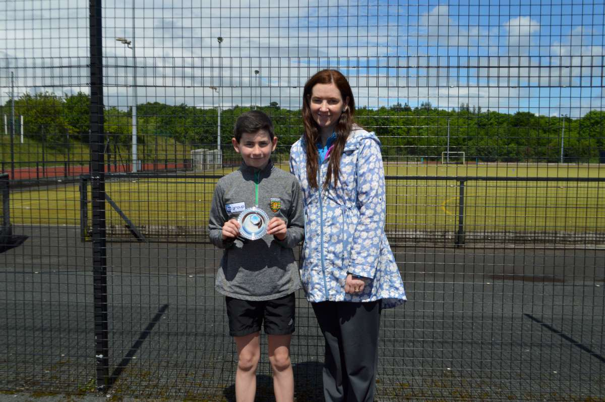 Top performer in Year 9 Edward Corry receives his award from Mrs McLaughlin