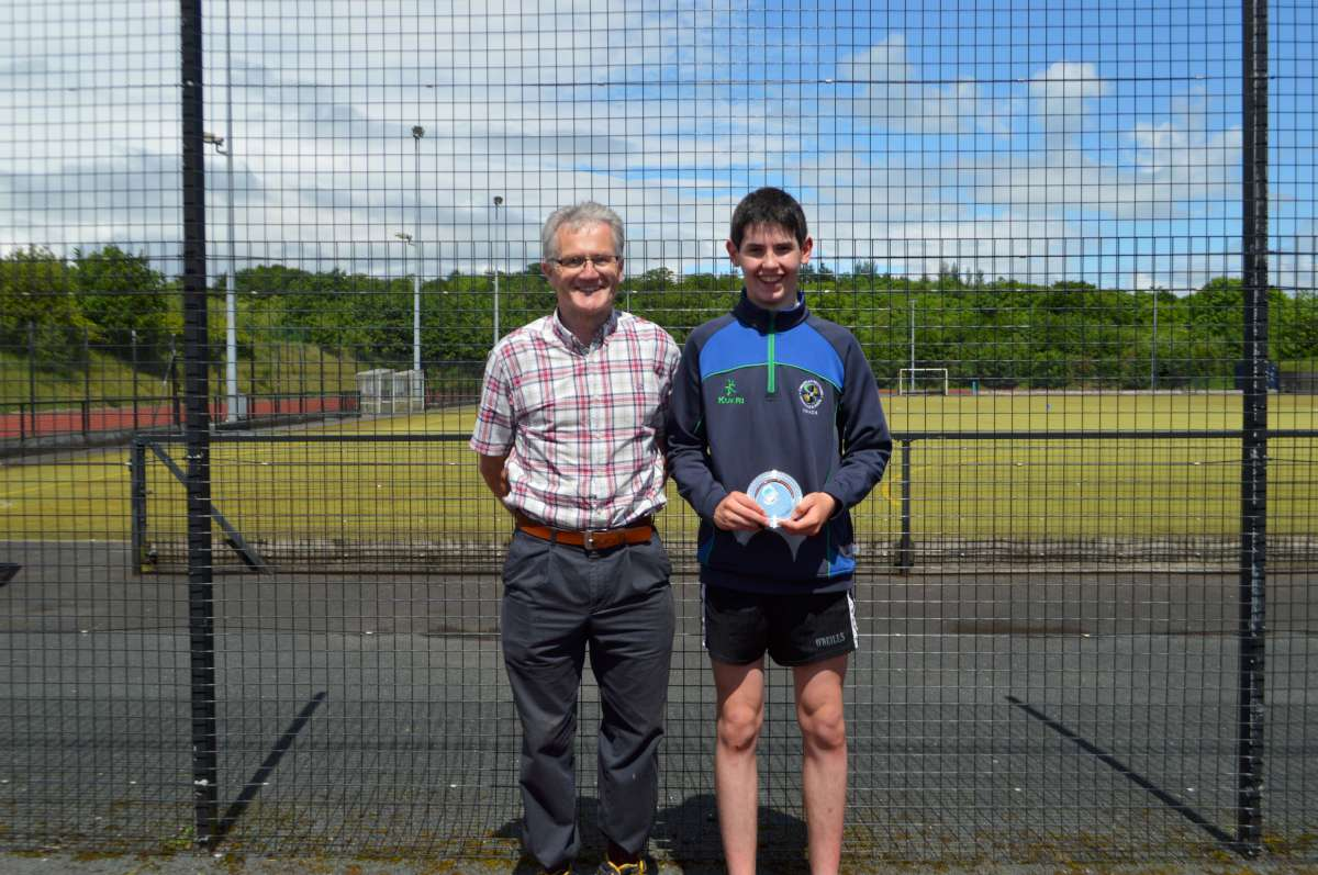 Top performer in Year 10 Oisin McGuigan receives his award from Mr Morris