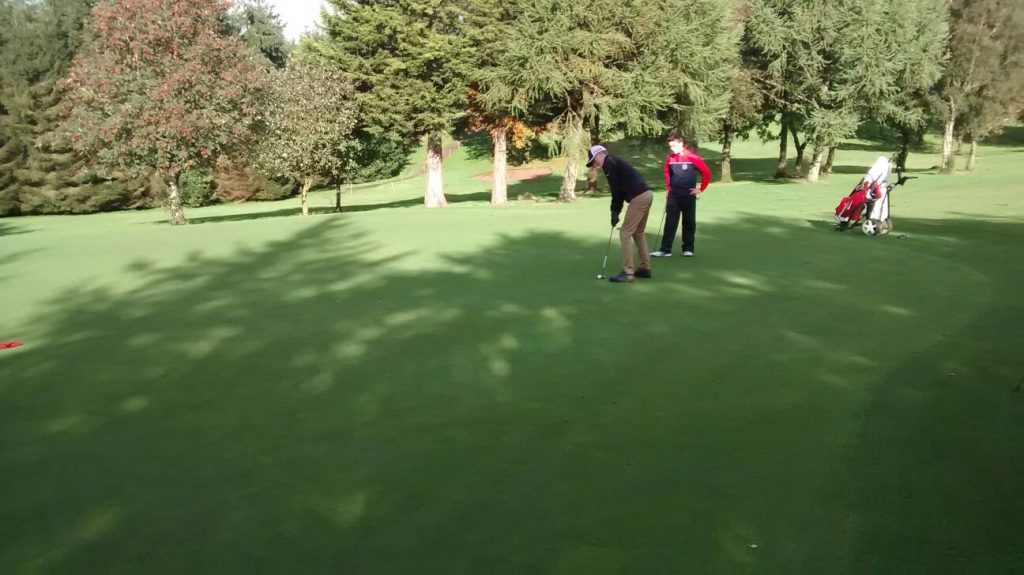 Sean Monan lines up his putt